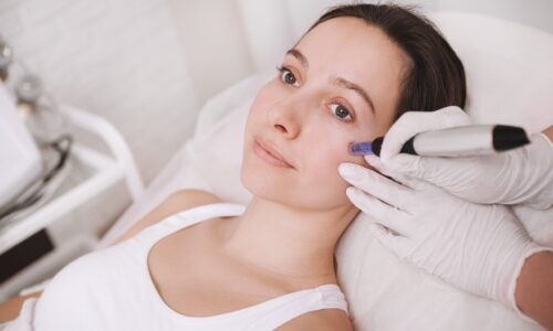 young-woman-getting-facial-skincare-treatment-min